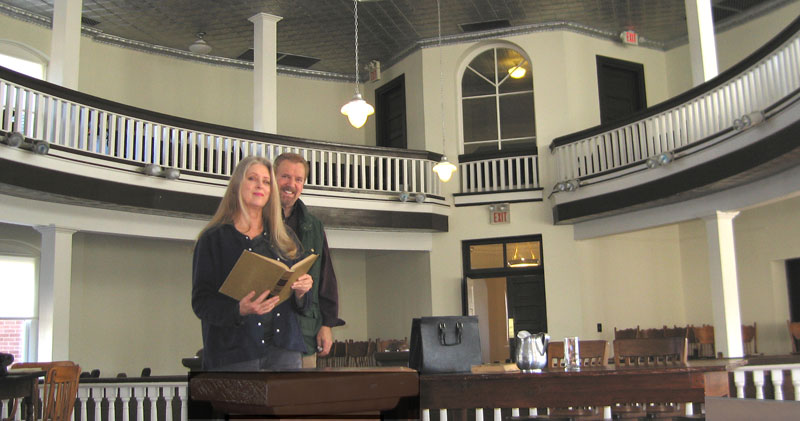 Jonathan Young and Anne Bach in the courtroom where To Kill a Mockingbird was filmed.