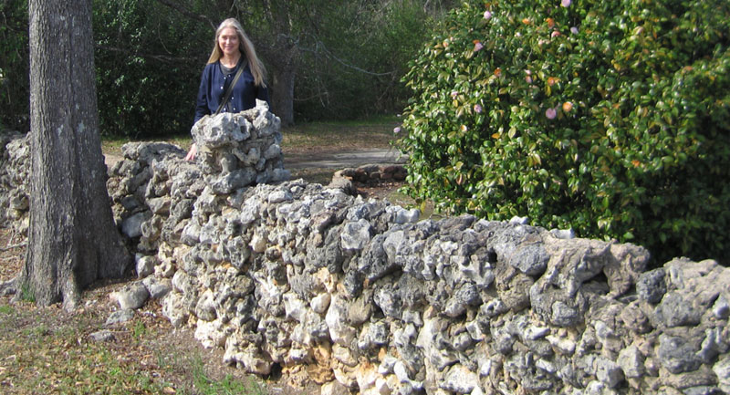 Anne Bach in Monroeville, Alabama, 2013 at the wall separating Truman Capote's home from the Faulk House